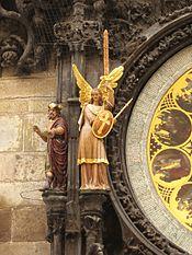 175px-Prazsky_orloj_sochy_filozof_a_andel